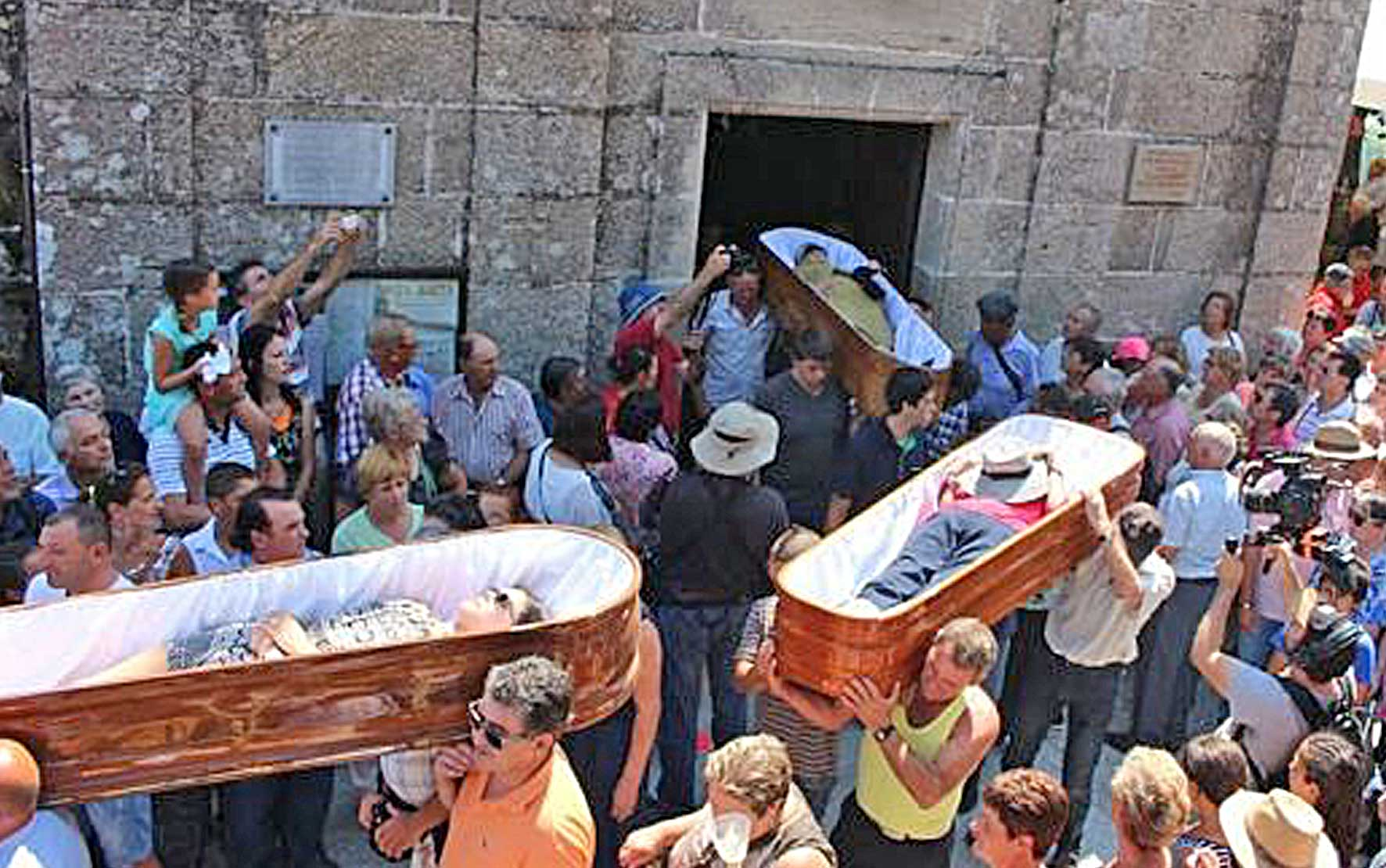 Festival of near death experiences marches through town with people in coffins